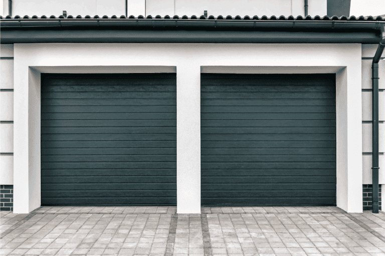Double modern closed garage door. Can You Replace A Panel On A Garage Door [And How To]
