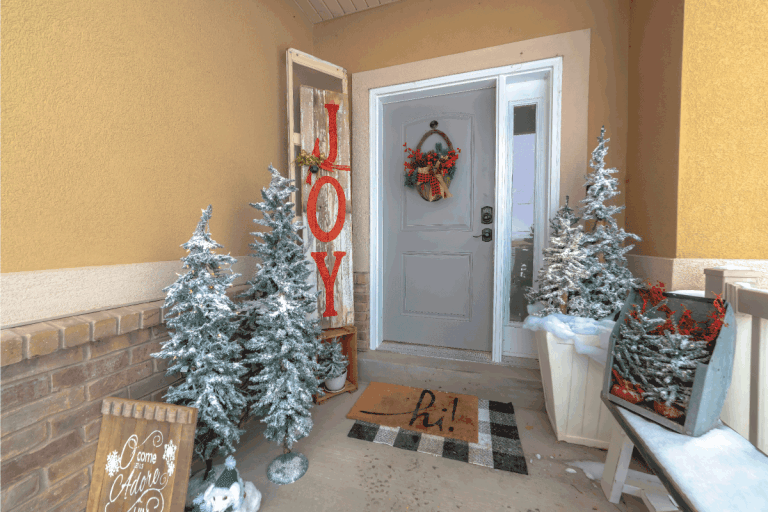 Festive home entrance with christmas trees holiday decorations and basket wreath. Can You Put A Screen Door On The Inside