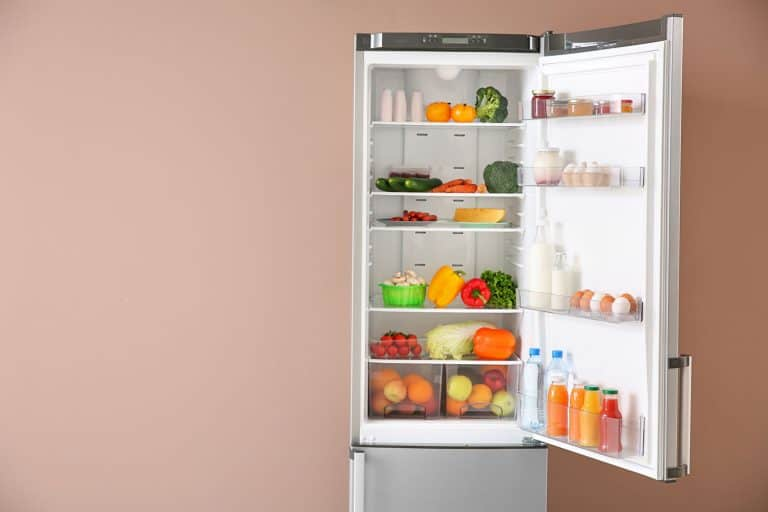 Open fridge full of food near color wall, How To Turn LG Refrigerator Door Alarm On And Off