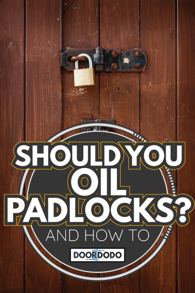 Rusty padlocks and locking bar on an old brown wooden panelled door Should You Oil Padlocks [And How To]