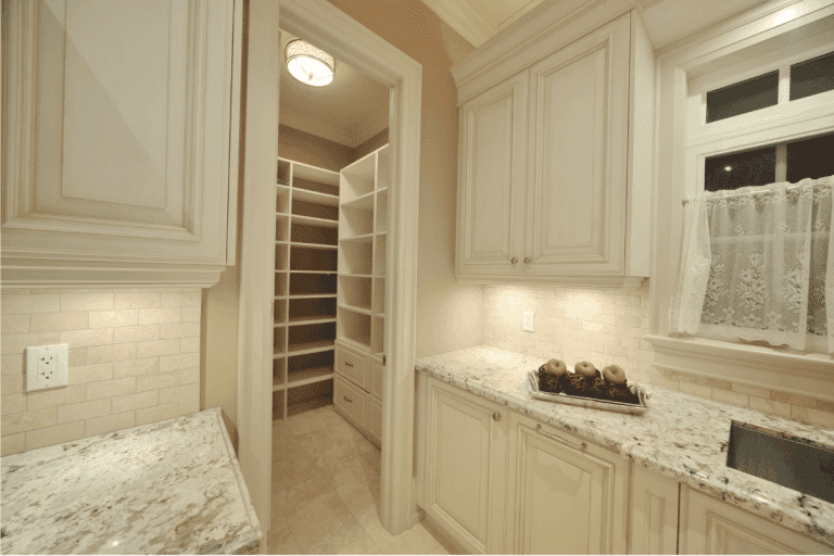 kitchen pantry with door and cabinets in matching cream color. Should Pantry Door Match Cabinets